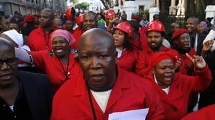 "Julius Malema and other Economic Freedom Fighters MPs leave parliament after shouting ""Pay back the money' at Zuma last August"
