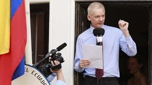 Julian Assange speaks from a balcony at Ecuador's embassy in London