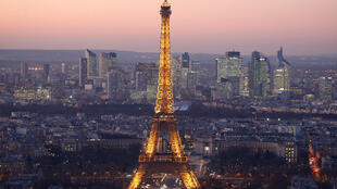 The Eiffel Tower with the La Défense business district  behind it