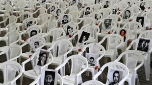 """Pictures of victims of human rights abuse are displayed before a ceremony to commemorate 40 years of the military coup at the """"Parque Por La Paz"""" (Park for Peace) on the grounds of the former Villa Grimaldi torture center in Santiago, 10 September 2013."""