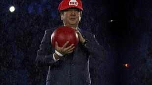 Prime Minister of Japan Shinzo Abe is seen on stage disguised as Super Mario during the 2016 Olympics closing ceremony in Rio on 21 August 2016.