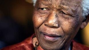 Former South African president Nelson Mandela pictured announcing his retirement from public life in June 2004