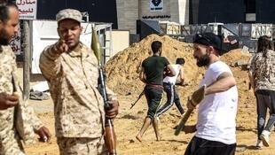 Libyan fighters loyal to the Government of National Accord run during clashes with forces loyal to Khalifa Haftar near the Libyan capital Tripoli.