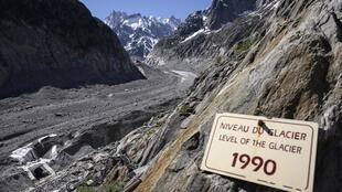 A sign indicates the level of the 'Mer de Glace' glacier in 1990 in Chamonix (French Alps) in that photo taken on 17 June 2019.