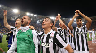 Juventus players celebrate after winning the Seria A title.
