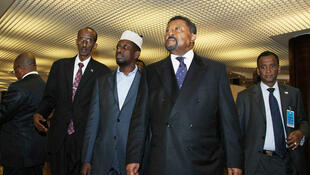 AU chair Jean Ping and Somalia's President Sharif Sheikh Ahmed arrive at the Addis Ababa summit