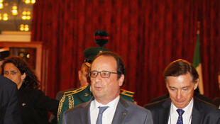 French President François Hollande is met by Nigerian Foreign Affairs Minister Geoffrey Onyeama on arrival in Abuja on Friday