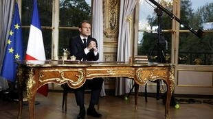 Emmanuel Macron making his speech on television from the Elysee Palace, Paris.