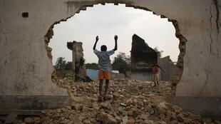 A boy in the ruins of  a Muslim religious centre in Bangui on Saturday