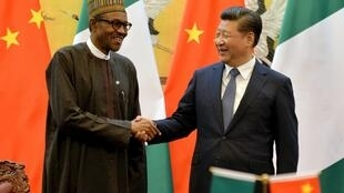 Nigeria's President Buhari and China's Xi Jinping shake hands during a signing ceremony in Beijing on 12 April, 2016.