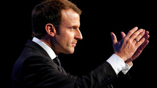 FILE PHOTO: French President Emmanuel Macron delivers a speech during the AMF congress, the annual meeting of French mayors, in Paris, France, November 23, 2017.