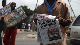A newspaper vendor on the streets of Lagos