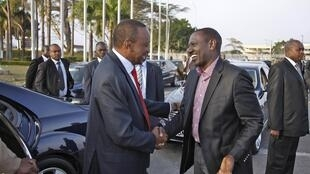 Kenya's President Uhuru Kenyatta bids farewell to his Deputy William Ruto before departing for the African Union summit in Addis Ababa, Nairobi, 12 October, 2013