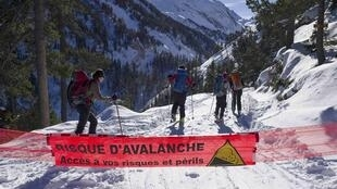 """Risk of Avalanche - Proceed at your own risk and peril"" - a banner in the French ski resort of Courcheval"