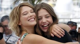 Cast members Léa Seydoux (L) and Adele Exarchopoulos of Blue is the Warmest Colour at the 66th Cannes Film Festival in Cannes May 23, 2013.