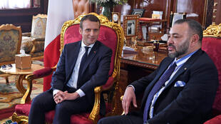 French President Emmanuel Macron (L) meets with Morocco's King Mohammed VI at the Royal Palace in Rabat, Morocco, June 14, 2017.
