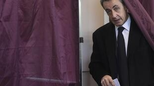 Nicolas Sarkozy voting in the first round of regional elections last Sunday