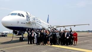 Alabama legislators with Airbus executives in front of a Jet Blue A320 at Mobile on Monday