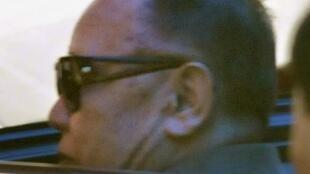 North Korean leader Kim Jong-il steps into a car at a hotel in Dalian, China