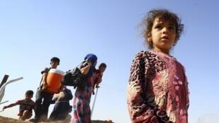 Deslocados que deixaram Mossul e encontraram refúgio perto do Curdistão iraquiano.