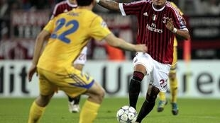 AC Milan's Kevin-Prince Boateng (R) fights for the ball