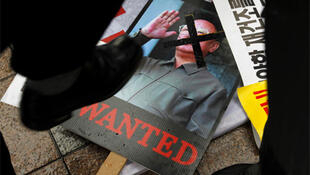 As tensions rise on the Korean peninsula, angry protesters in Seoul stamp on pictures of North Korea's leader Kim Jong-Il.