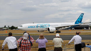 Spectators look at an Airbus A330-900 at the Farnborough Airshow