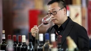 A Chinese winelover tastes at the Shanghai International Wine Trade Fair