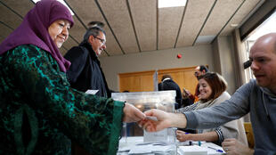 Voters cast their ballots in Barcelonam, 21 December