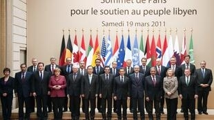 US, European and Arab leaders pose for photo at the Elysee Palace in Paris, 19 March 2011