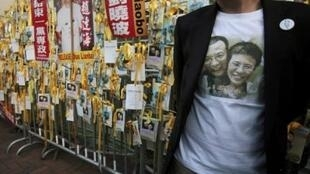 A protester wearing a t-shirt showing a picture of Liu Xiaobo and his wife Liu Xia