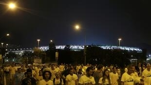 Football fans leave the Maracana stadium (background) after the Confederations Cup final soccer match in Rio de Janeiro 30 June 2013