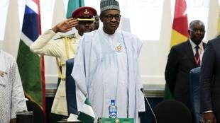 Nigeria's President Muhammadu Buhari (C) stands at the opening of the 48th ordinary session of ECOWAS Authority of Head of States and Government in Abuja, Nigeria, December 16, 2015
