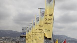 Banners erected by Hezbollah depicting Pope Benedict XVI as well as Lebanese and Vatican flags decorate a main airport road in Beirut.