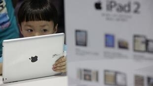 A child plays with an iPad