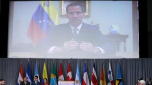 O líder da oposição venezuelana e autoproclamado presidente interino, Juan Guaidó, participou por videoconferência da reunião do Grupo de Lima em Ottawa, no Canadá, em 4 de fevereiro de 2019.