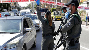 Israeli police check vehicles at a checkpoint in the ultra-Orthodox city of Bnei Brak, near Tel Aviv