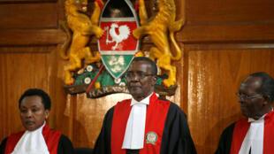 Kenya's Supreme Court judge chief justice David Maraga (C) presides before delivering the ruling making last month's presidential election in which Uhuru Kenyatta's win was declared invalid in Nairobi, Kenya September 1, 2017.