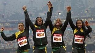 Christine Day, Shericka Jackson, Stephenie Ann McPherson and Novlene Williams-Mills of Jamaica win the women's 4x400 metres relay.