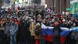 Des partisans de l'opposant Alexeï Navalny, réunis à Moscou, pour prôner le boycott de l'élection présidentielle de mars prochain, le dimanche 28 janvier 2018.