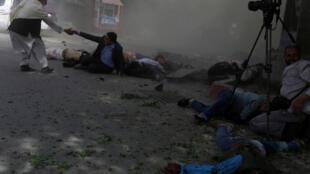 Второй взрыв прогремел, когда на место прибыли журналисты и полицейские, 30 апреля 2018 года, Кабул, Афганистан.