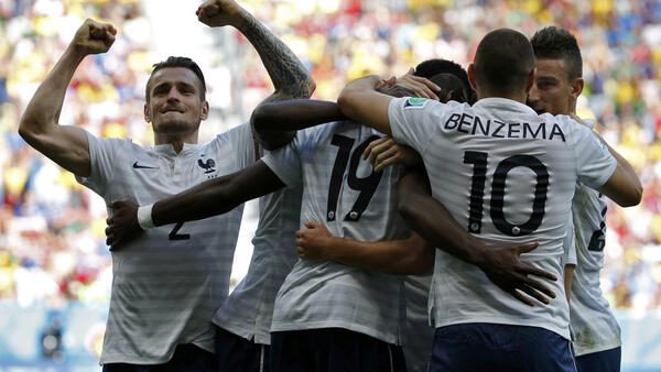 The French team celebrates after a goal by Paul Pogba in their match against Nigeria.