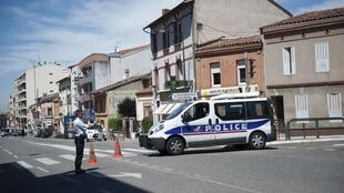 French police block the road where the hostage-taking is taking place