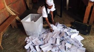 An election official counts ballots at a polling station in Rwandan capital Kigali. 9 August
