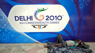 A labourer sleeps outside the Thyagraj sports complex in New Delhi.