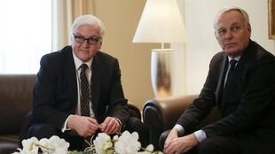 German Foreign Minister Frank-Walter Steinmeier (L) with Jean-Marc Ayrault at Tegel airport in Berlin