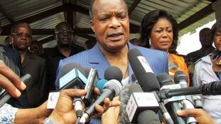 Sassou Nguesso talking to the media after voting in the constitutional referendum on 25 October 2015, Brazzaville