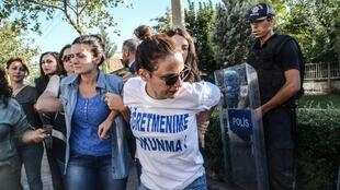 "Turkish police arrest a teacher wearing a T-shirt reading ""Don't touch my teacher!"" in Diyarbakir on September 24, 2016."