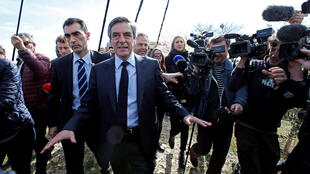 Francois Fillon (C), former French prime minister, member of the Republicans political party and 2017 presidential election candidate of the French centre-right walks in vineyards after a meeting with winegrowers in Nimes, France, March 2, 2017.