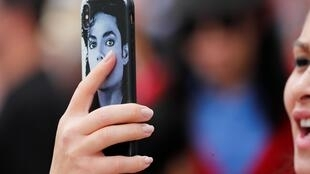 Michael Jackson fan clubs file a suit in France using defamation laws that make it an offence to wrongfully sully the image of a dead person.